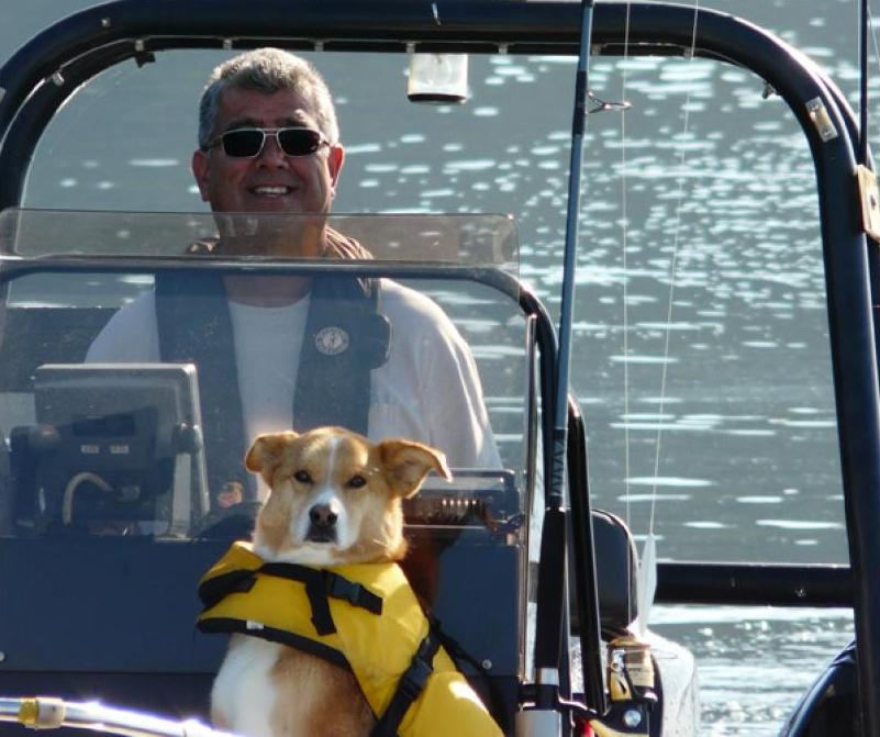 Man and dog on a boat